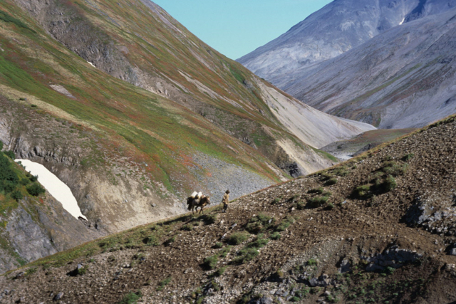 Koryak and his horse in the mountains, Kamchatka